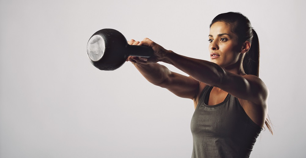 Woman exercise with kettle bell - Crossfit workout